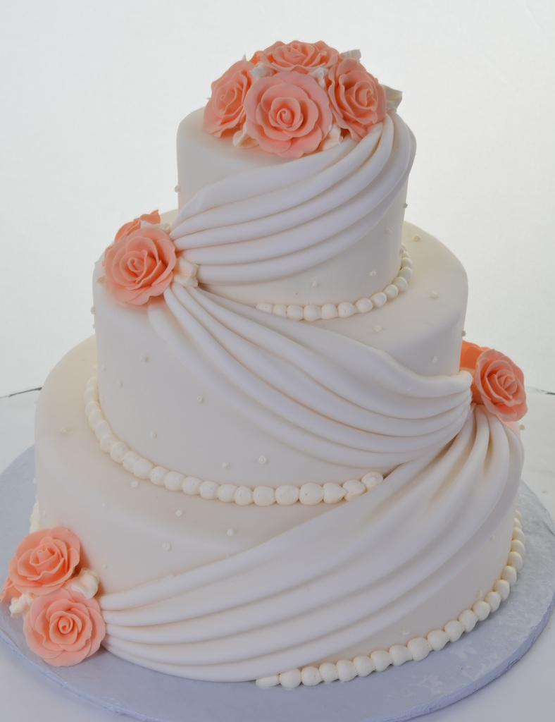 Three Round Tiers Dressed In Pure White Fondant Are Like A Breath Of Fresh Air Immaculate Swags Add Interest And Note Sophistication That Keeps