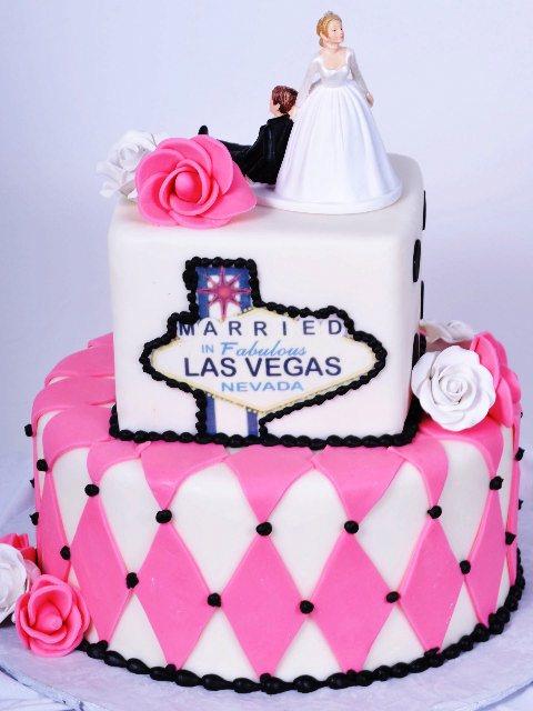 Vegas theme wedding cake with pink