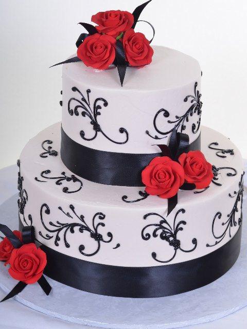 black scrolls with red flower wedding cake
