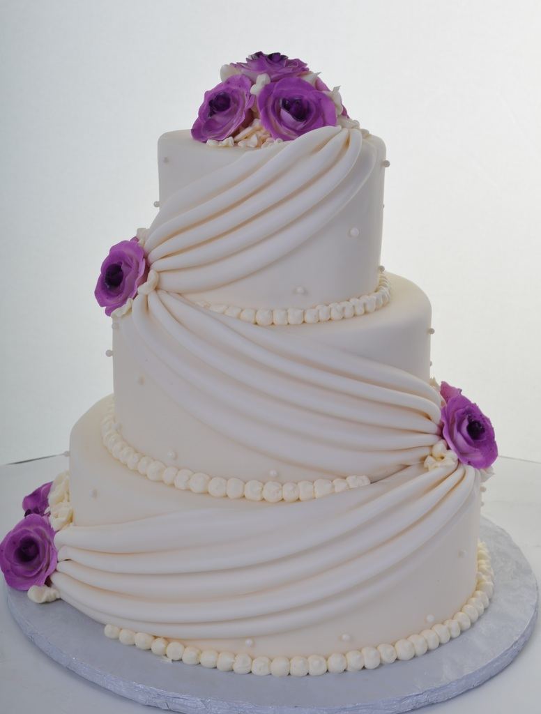 Pastry Palace Las Vegas Wedding Cake 569 - Ivory Swags with Violet Roses